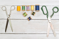 Top view on old scissors, cottons  on wooden desk Stock Image
