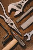 Top view of old shabby mechanical tools on brown. Surface stock photos