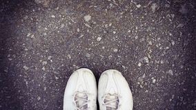 Top view of old sneaker on street with copy space, vintage style Stock Image