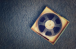 Top view of old sound recording tape, reel to reel type and box. Stock Image