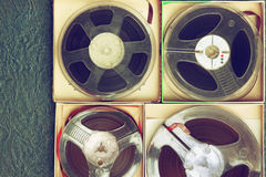 Top view of old sound recording tape, reel to reel type and box Royalty Free Stock Photos