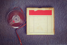 Top view of old sound recording tape, reel to reel type and box with room for text. filtered image Stock Images