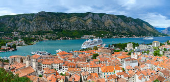 Top view of Old town and cruise ship in Bay of Kotor, Montenegro. KOTOR, MONTENEGRO - SEPTEMBER 21, 2015: Top view of the Old town and cruise ship in the Bay of royalty free stock photos