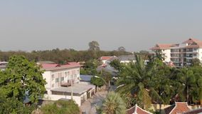 Top view of the old town with red orange tiled roofs of houses. Flying past the window of a private house. Pattaya, Thailand. Top view of the old town with red stock video footage