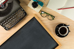Top view of old typewriter, camera, notebook, glasses, cofee and Stock Image