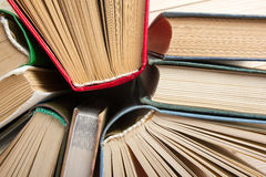 Top view of old used colorful hardback books. Back to school. Stock Photos