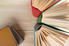 Top view of old used colorful hardback books. Back to school. Royalty Free Stock Photos