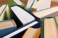 Top view of old used colorful hardback books. Back to school. royalty free stock photo