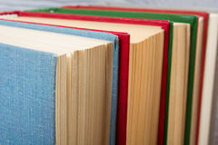 Top view of old used colorful hardback books. Back to school. Top view of old used colorful hardback books. Back to school Royalty Free Stock Photo