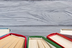 Top view of old used colorful hardback books. Back to school. Stock Photo