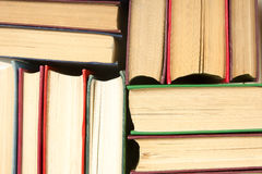 Top view of old used colorful hardback books. Back to school. Royalty Free Stock Images