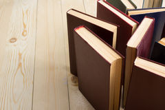 Top view of old used colorful hardback books. Back to school. Stock Images