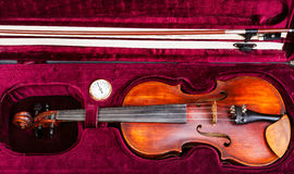 Top view of old violin with bow in red velvet case Royalty Free Stock Photo
