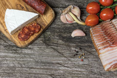 Top view of the old wooden desk with sausages and cheese Stock Photo