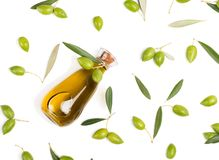 Fresh olives and olive oil, above view. Royalty Free Stock Image