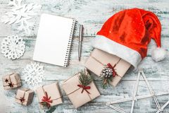 Free Top View On Nice Christmas Gifts Wrapped In White Gift Paper, Christmas Tree Decorations In Santa`s Hat. Stock Image - 104874181