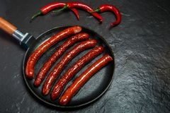 Top View On Round Pan With Five Long Fried Hunting Sausages Stock Image