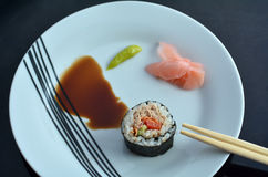 Top view of one Makizushi sushi fresh maki roll served on a plat Royalty Free Stock Image