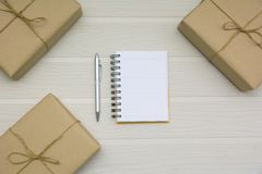 Top view of open book. Book open with pen and boxes on wooden ba royalty free stock images