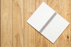 Top view of open book on wooden table Stock Photography
