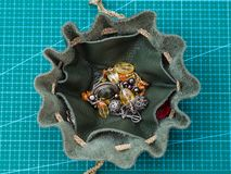 Top view of open drawstring pouch with jewelry royalty free stock images
