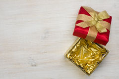Top view of open gift box on wooden texture background Royalty Free Stock Images