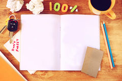 Top view of open note book, cup of coffee and crumpled paper Stock Photography