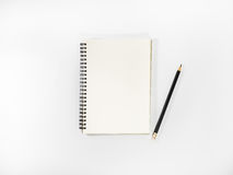 Top view open notebook and pencil potted. Top view open notebook and pencil potted on white background Stock Photography