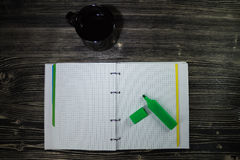 Top view of open notebook on which lies a pen and near the Cup of coffee. Stock Photography