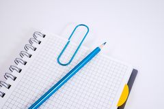 Top view of open spiral blank notebook with pencil on white desk background stock image