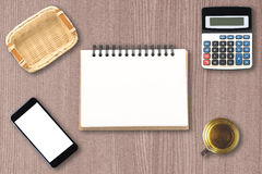Top view of open spiral blank notebook with smartphone, calculat Stock Photos