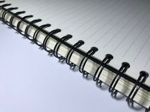 Top view of open spiral blank notebook. On white desk background The shadow of the lamp. Overtime Stock Photos