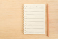Top view of open spiral line paper notebook and brown pencil on Stock Image