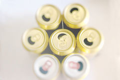 Opened golden beer cans Royalty Free Stock Photo