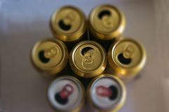 Opened golden beer cans Stock Photography