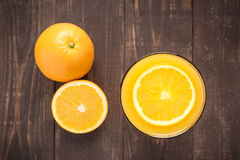 Top view orange juice on wooden background Stock Photos