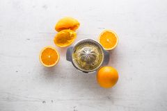 Top of view Orange and juicer on white concrete background Stock Image