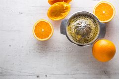 Top of view Orange and juicer on white concrete background Stock Photos