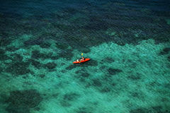 Top view of orange kayaks in the sea. Tourists mom and baby on g Royalty Free Stock Photo