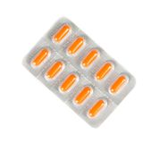 Top of view of orange pills packed in blister isolated Stock Image
