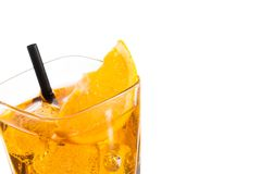 Top of view of orange slice on top of the yellow cocktail with ice cubes and straw on white background Royalty Free Stock Image