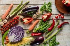 Organic ripe vegetables. Top view of organic ripe vegetables on wooden tabletop Stock Photos