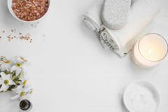 Top view of organic skincare products with salt, candle, flowers Stock Photos