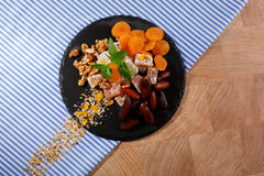 Top view of organic sweet snacks. Turkish delight with fruits and nuts. Exotic marmalade dessert on a fabric background. Stock Photo