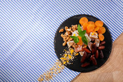 Top view of organic sweet snacks. Turkish delight with fruits and nuts. Exotic marmalade dessert on a fabric background. Royalty Free Stock Photography