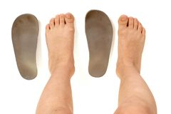 Orthopedic insoles and legs. Top view of orthopedic insoles for shoes and kids legs stock photos