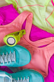 Top view of outfit for runner on wooden background. Running shoes,  shorts, shirt, and sport bra. Horizontal orientation Royalty Free Stock Images