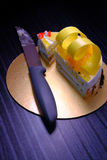 Top view ov half Lemon cake with knif  with on black background Royalty Free Stock Image