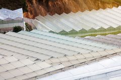 Top view over the glass roof of a greenhouse creating a surreal manmade landscape. Royalty Free Stock Images