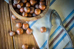 Top view over hazelnuts in bowl and nut cracker Stock Photo